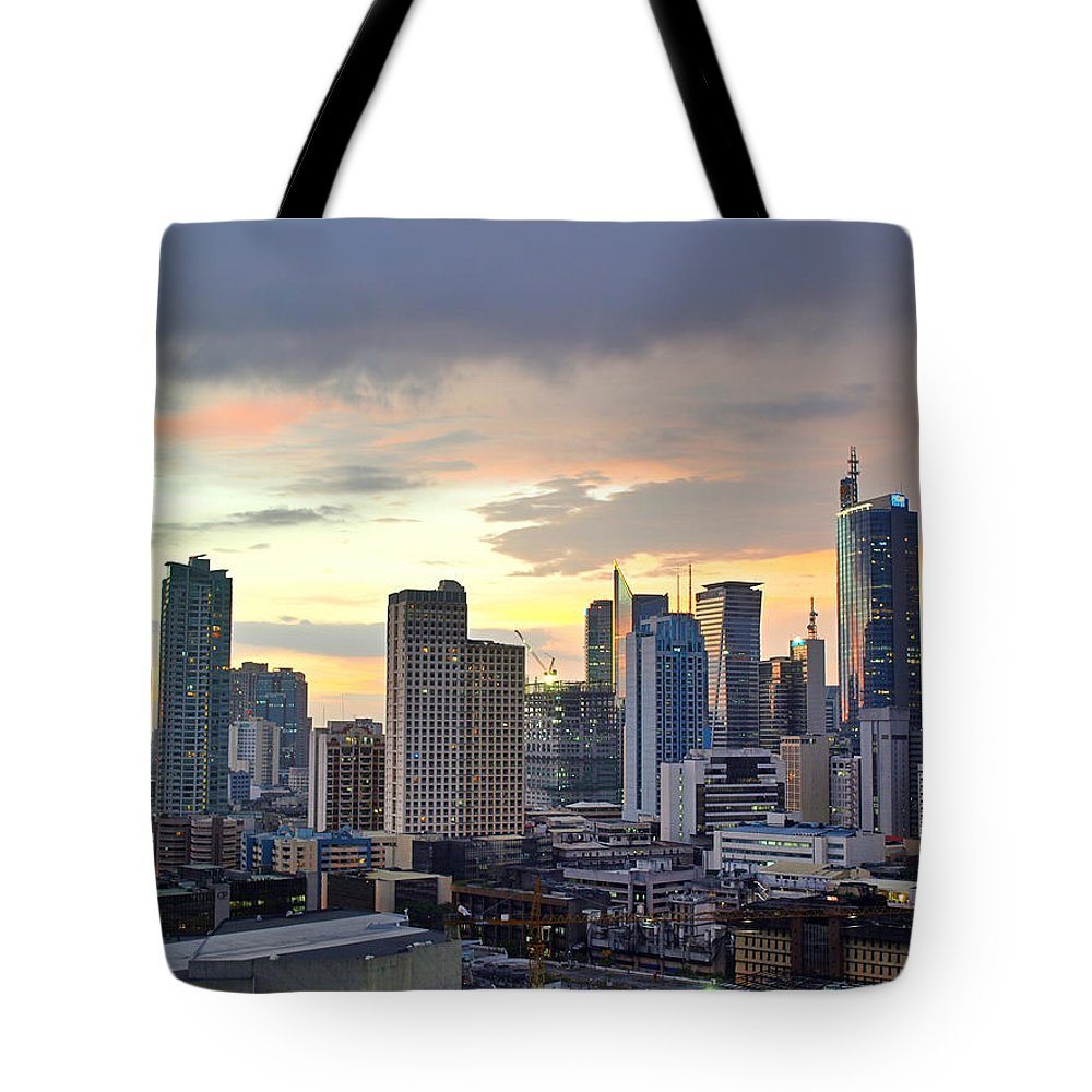 Outdoors Tote Bag featuring the photograph Sunset Over Makati City, Manila by Neil Howard