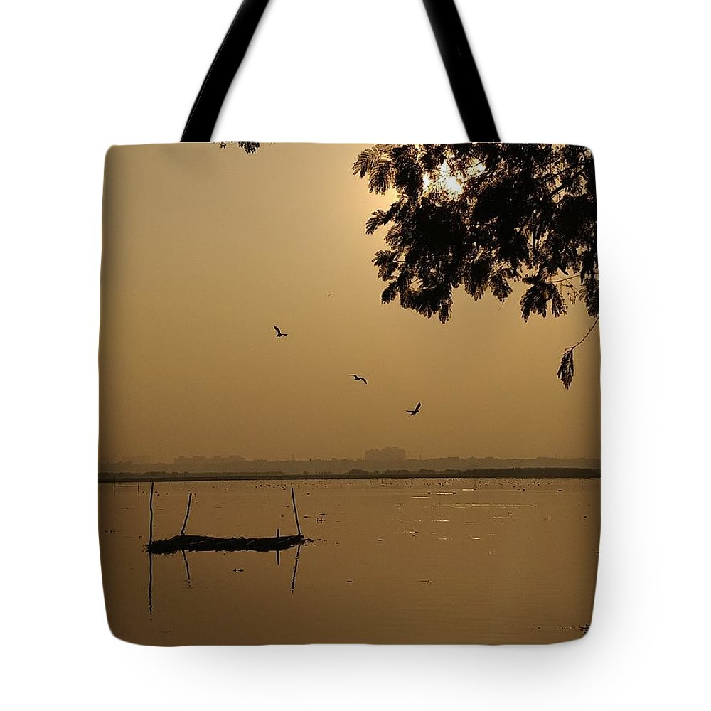 Sunset Tote Bag featuring the photograph Sunset by Priya Hazra