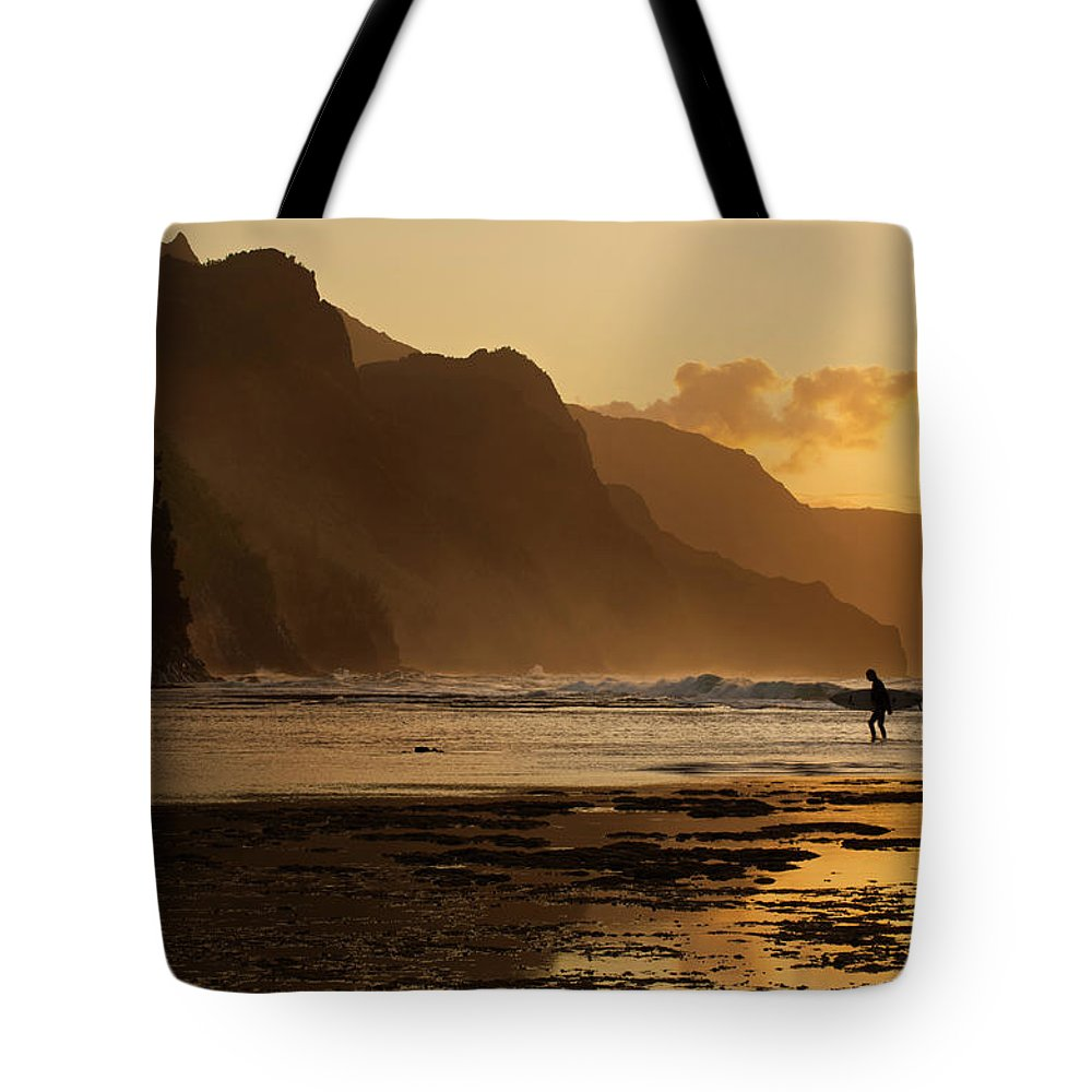 Tranquility Tote Bag featuring the photograph Surfer On Beach And Na Pali Coast Seen by Enrique R. Aguirre Aves