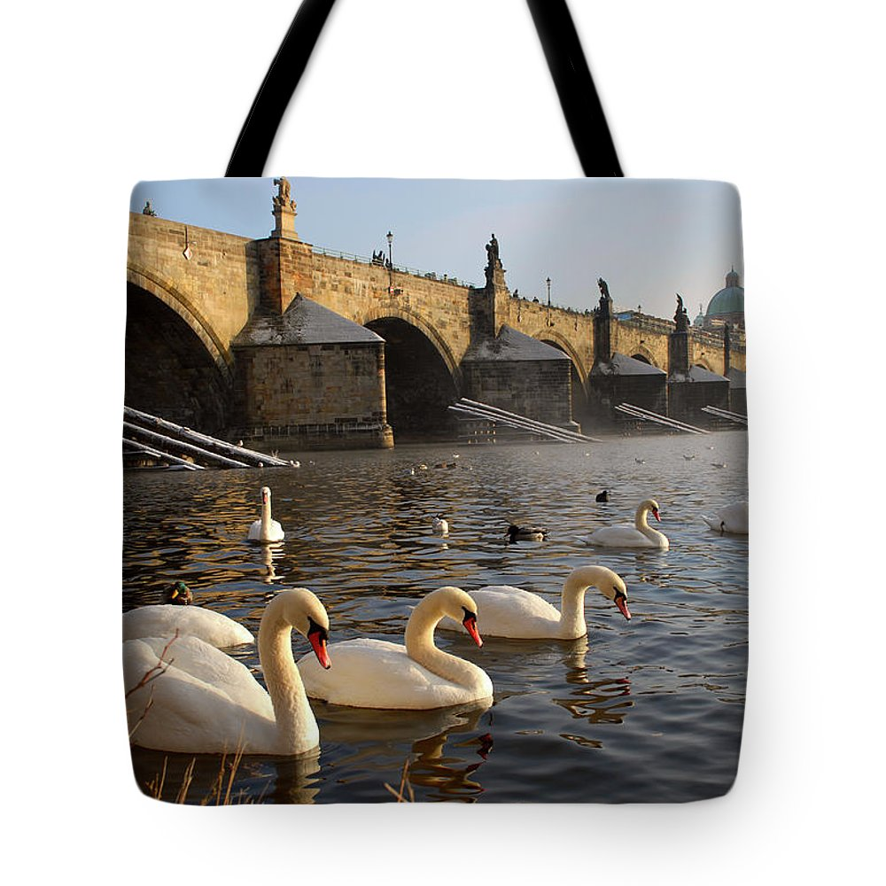 Arch Tote Bag featuring the photograph Swans And Charles Bridge by Dibrova