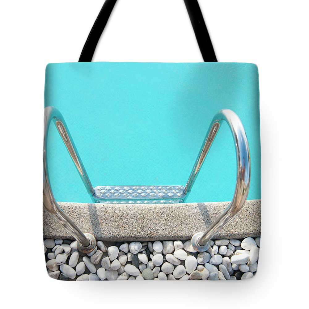 Tranquility Tote Bag featuring the photograph Swimming Pool With White Pebbles by Lawren