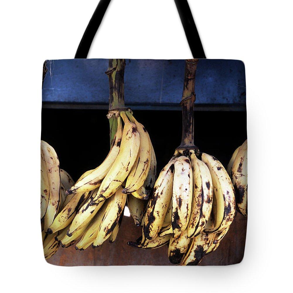 Hanging Tote Bag featuring the photograph Tanzania, Zanzibar, Bananas For Sale In by John Seaton Callahan