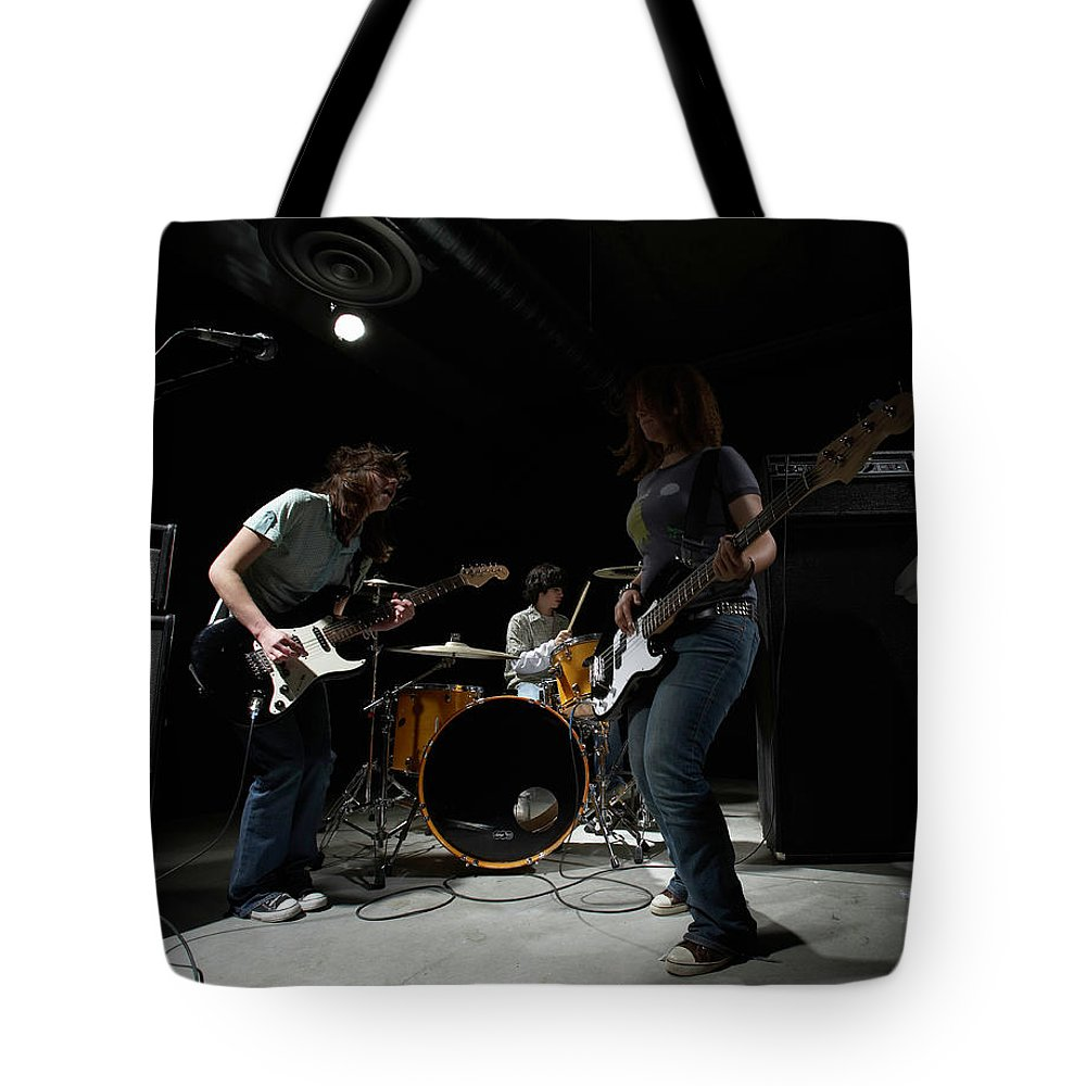 Cool Attitude Tote Bag featuring the photograph Teenage 14-16 Band Playing Instruments by Thomas Northcut