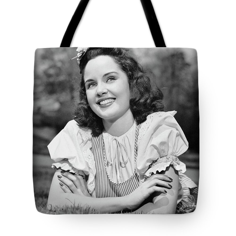 People Tote Bag featuring the photograph Teenage Girl Lying On Grass by George Marks
