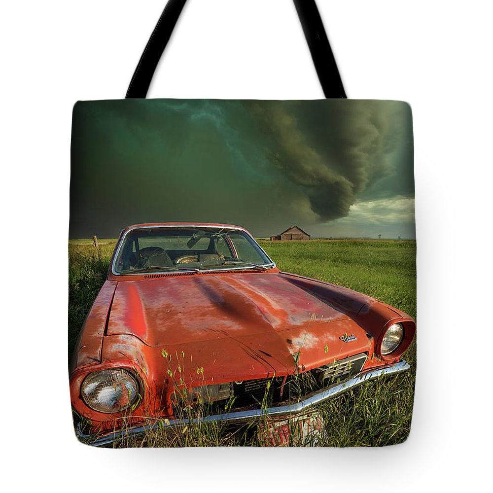 A Windy Violent Storm Tote Bag featuring the photograph Tempest by Aaron J Groen