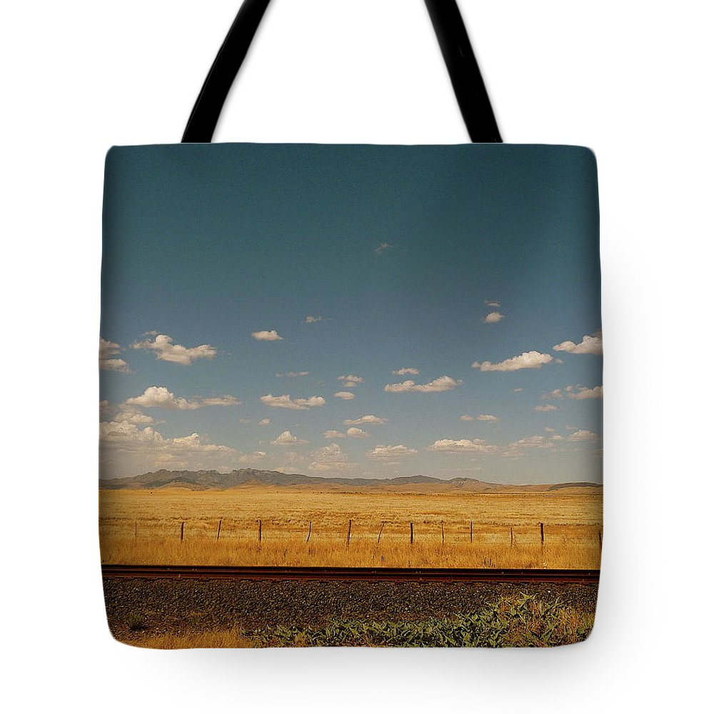Tranquility Tote Bag featuring the photograph Texan Desert Landscape And Rail Tracks by Papilio