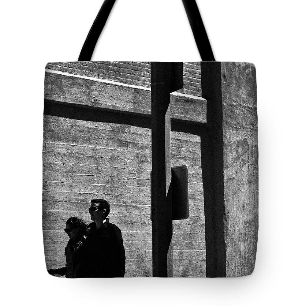 Streets Streetphotography B&w People Couples Walking Shadows Backround Love Life Live Mundane Tote Bag featuring the photograph The Couple No.1 In A Series by Salvatore Sgroi
