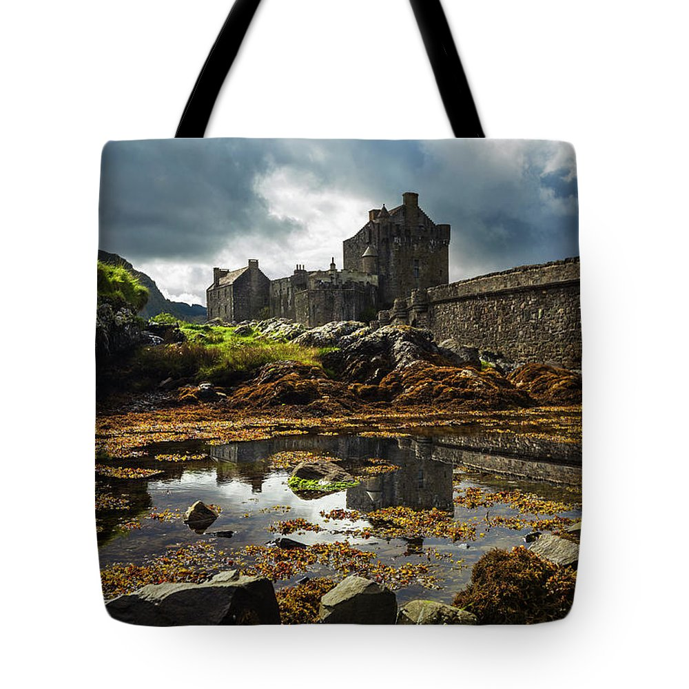 Clouds Tote Bag featuring the photograph The Eilean Donan Castle by Debra and Dave Vanderlaan
