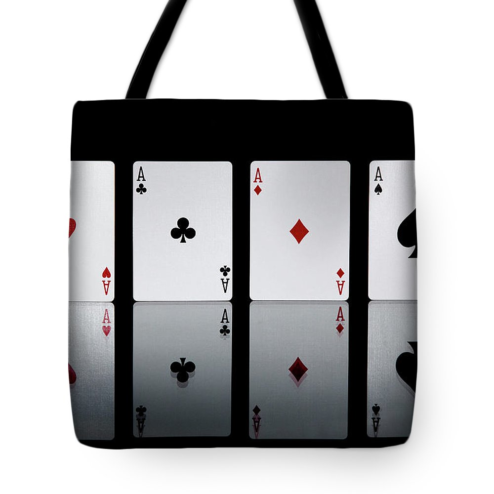 Risk Tote Bag featuring the photograph The Four Aces From A Pack Of Playing by Sasha Weleber