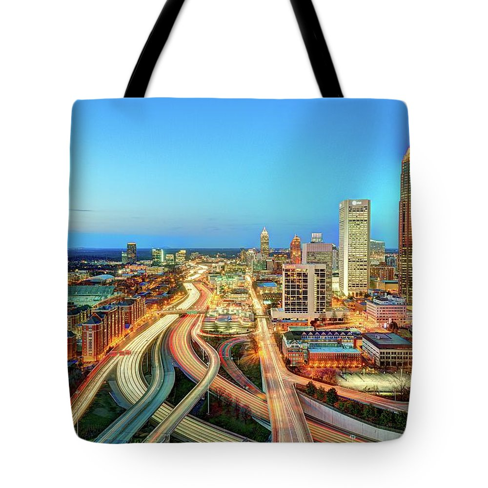 Atlanta Tote Bag featuring the photograph The Lifeblood Of Atlanta by Photography By Steve Kelley Aka Mudpig