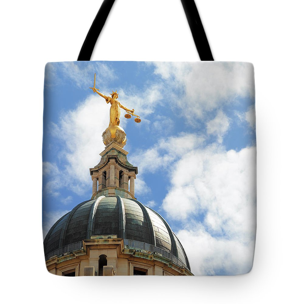 Statue Tote Bag featuring the photograph The Old Bailey, Central Criminal Court by Peter Dazeley