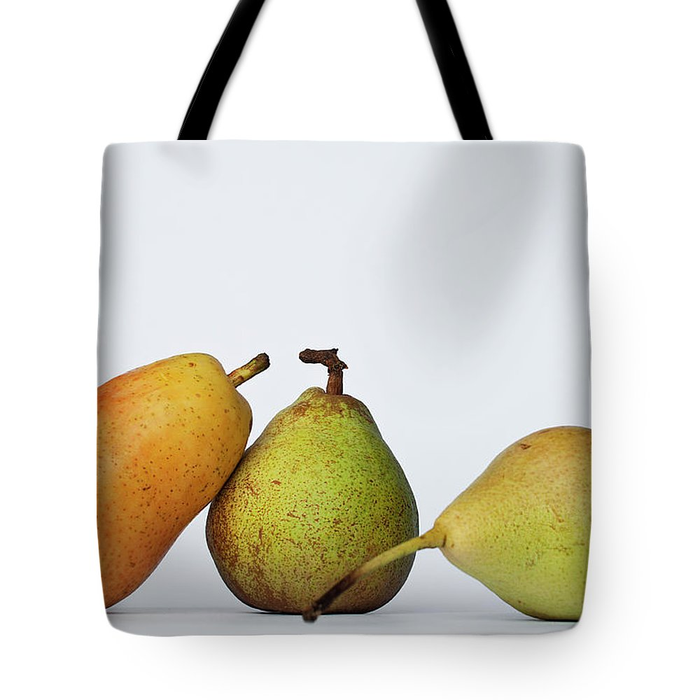 Healthy Eating Tote Bag featuring the photograph Three Diferent Pears Isolated On Grey by Irantzu Arbaizagoitia Photography