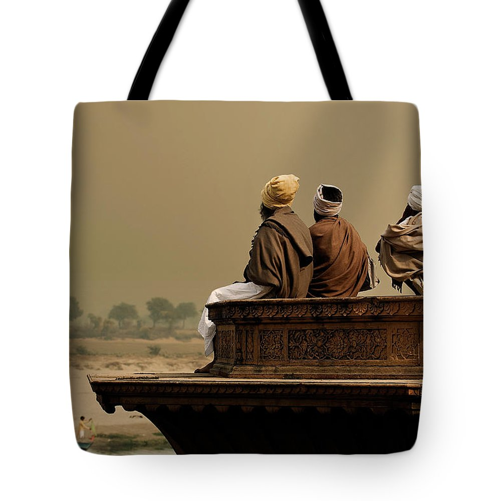 Water's Edge Tote Bag featuring the photograph Three Sadhus Meditating By The Yamuna by Globalstock