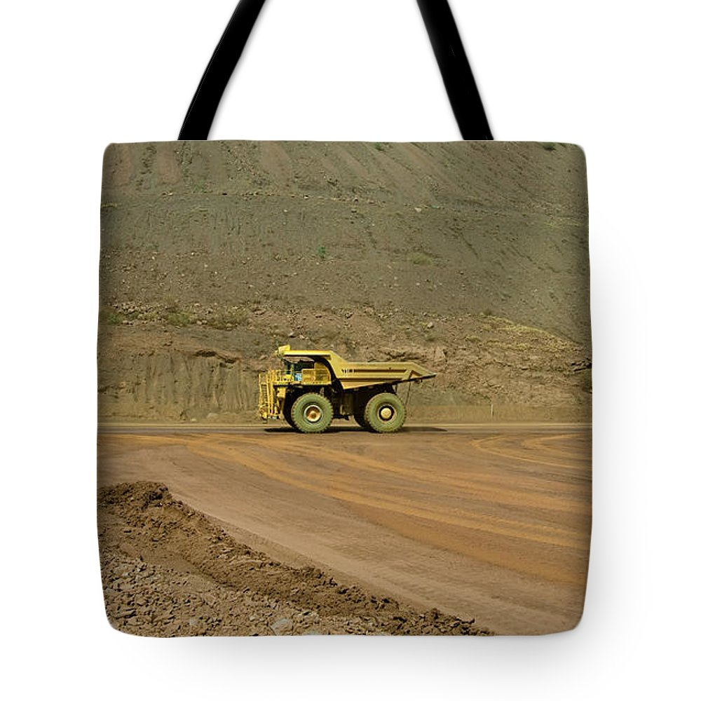 Southern Hemisphere Tote Bag featuring the photograph Tom Price Earthmover by Samvaltenbergs