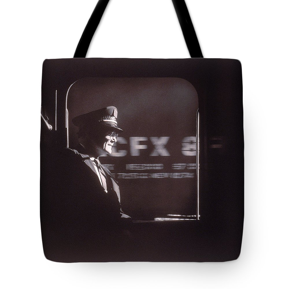 Working Tote Bag featuring the photograph Train Conductor Looking Out Of Window by John Coletti