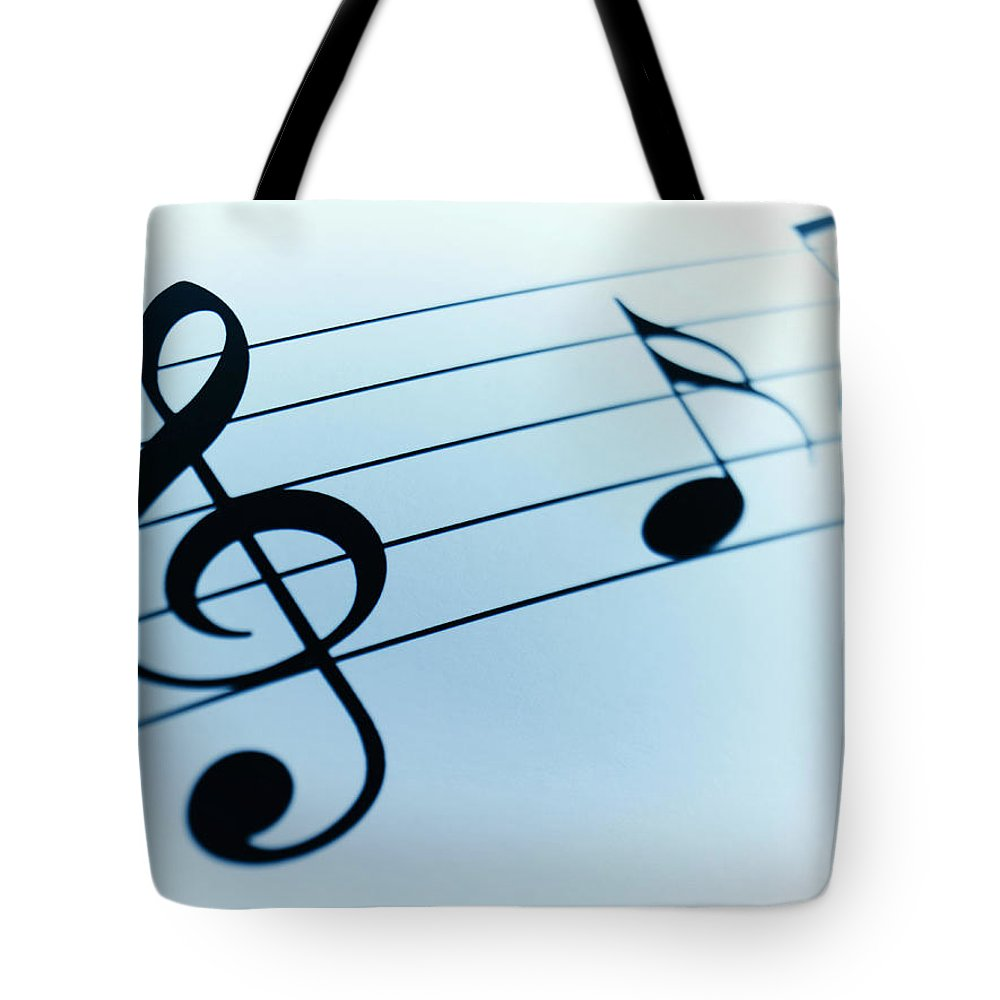 Sheet Music Tote Bag featuring the photograph Treble Clef And Notes by Adam Gault