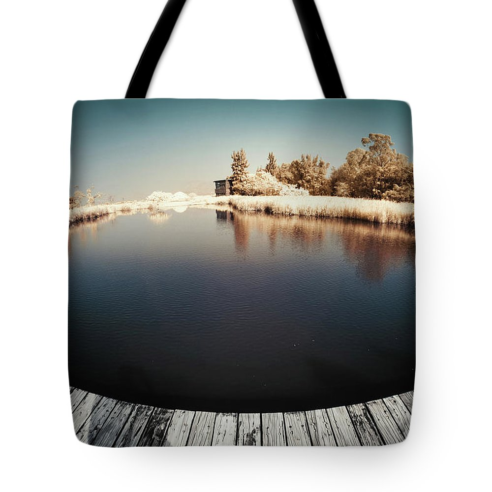Tranquility Tote Bag featuring the photograph Trees And Plants In A Pond by D3sign