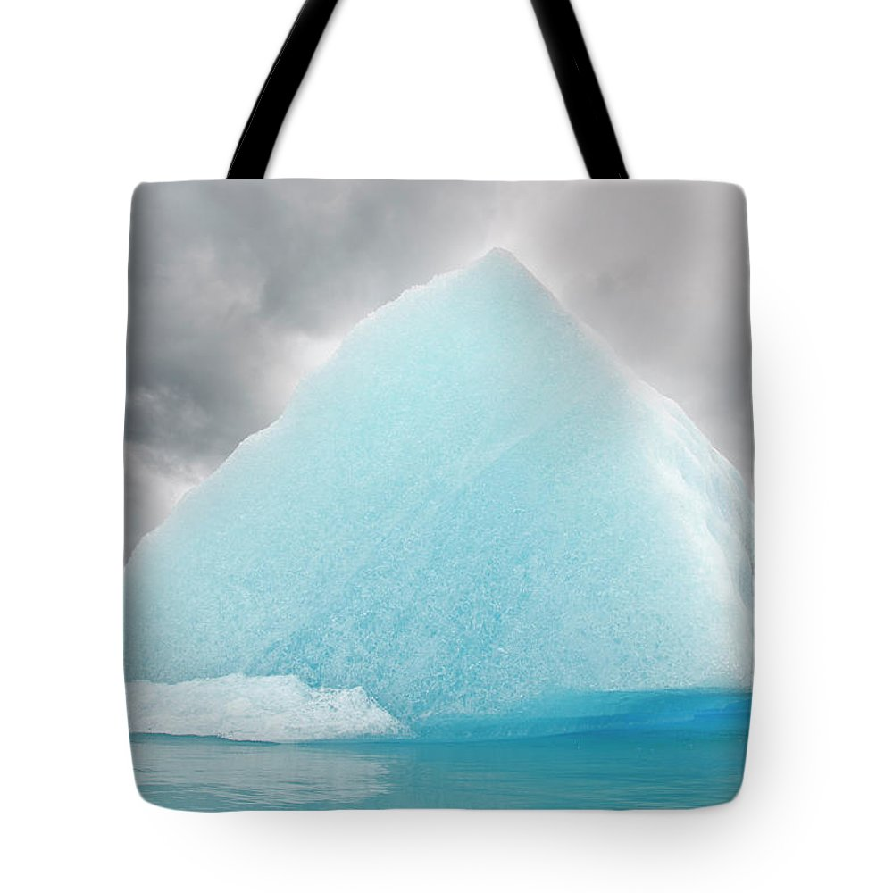 Iceberg Tote Bag featuring the photograph Triangular Iceberg On Gloomy Day, Bear by James + Courtney Forte