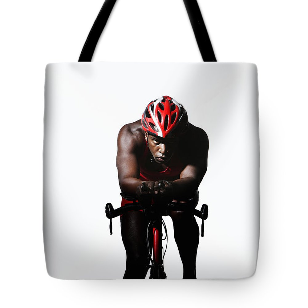 Three Quarter Length Tote Bag featuring the photograph Triathlete Riding On Bicycle by Paul Taylor