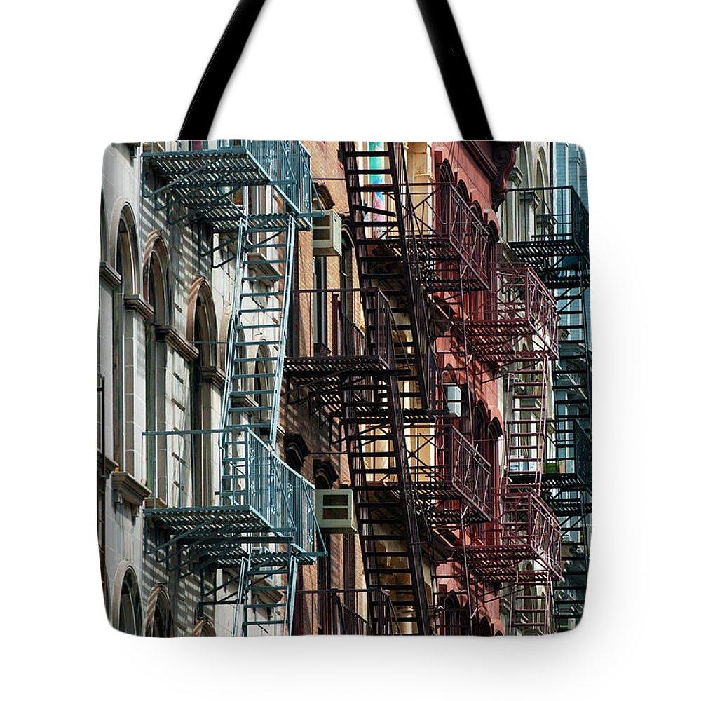 Downtown District Tote Bag featuring the photograph Tribeca Fire Escapes by Joseph O. Holmes / Portfolio.streetnine.com