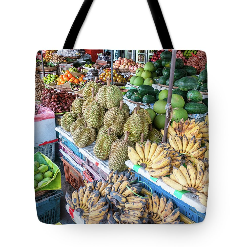 Mango Fruit Tote Bag featuring the photograph Tropical Fruit At A Street Market In by Tbradford