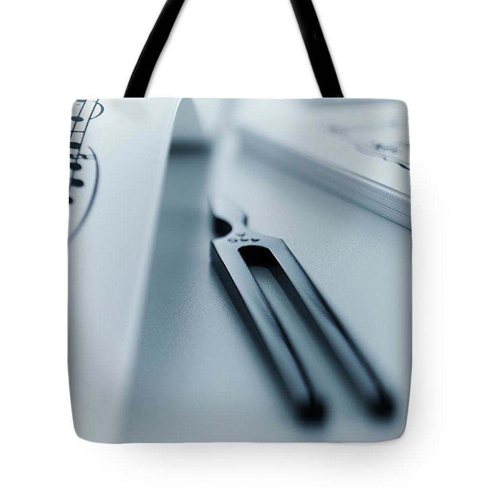 Adjusting Tote Bag featuring the photograph Tuning Fork by Adam Gault