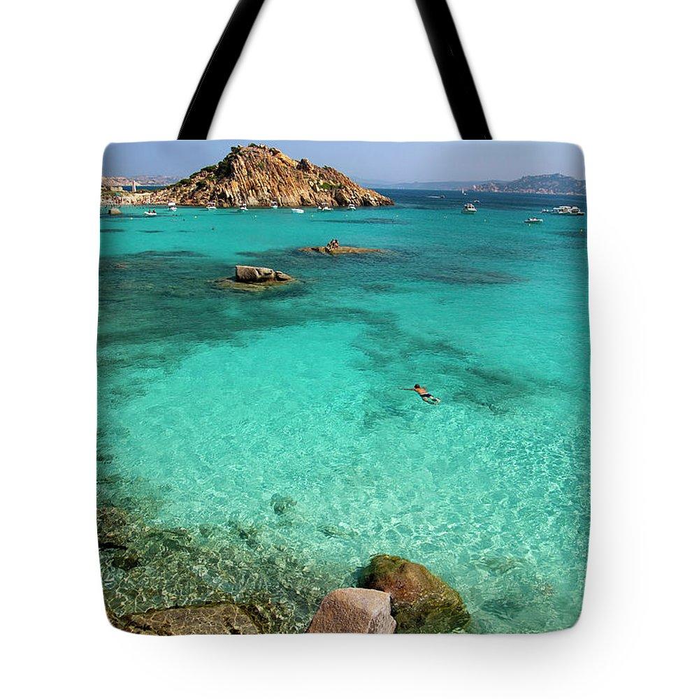 Scenics Tote Bag featuring the photograph Turquoise Sea And Boats At La Maddalena by Vito elefante