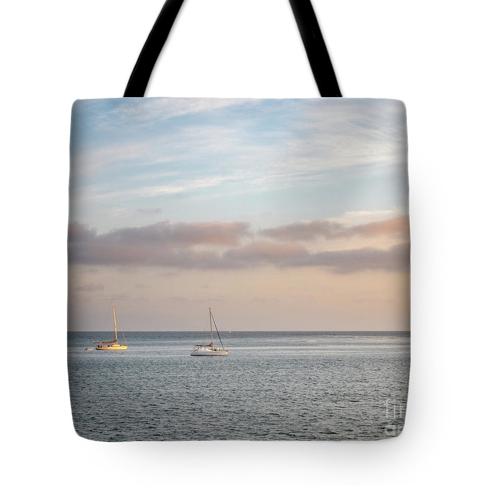California Tote Bag featuring the photograph Two Sail Boats In Ocean Sea Facing The Sunset During The Golden by PorqueNo Studios