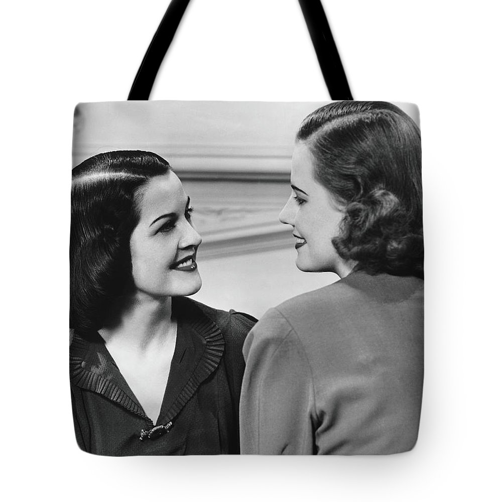 People Tote Bag featuring the photograph Two Women Conversing In Living Room, B&w by George Marks