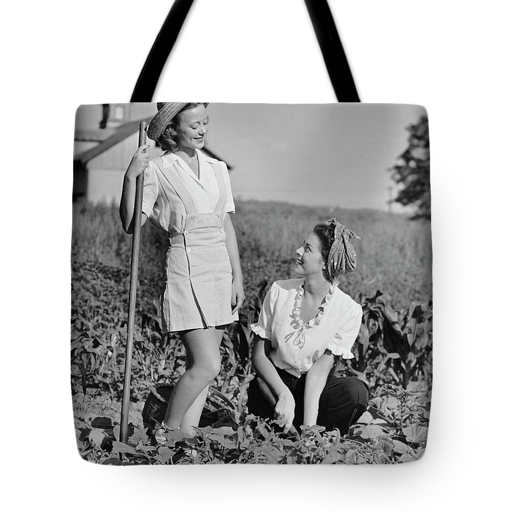 People Tote Bag featuring the photograph Two Women Gardening In Field by George Marks