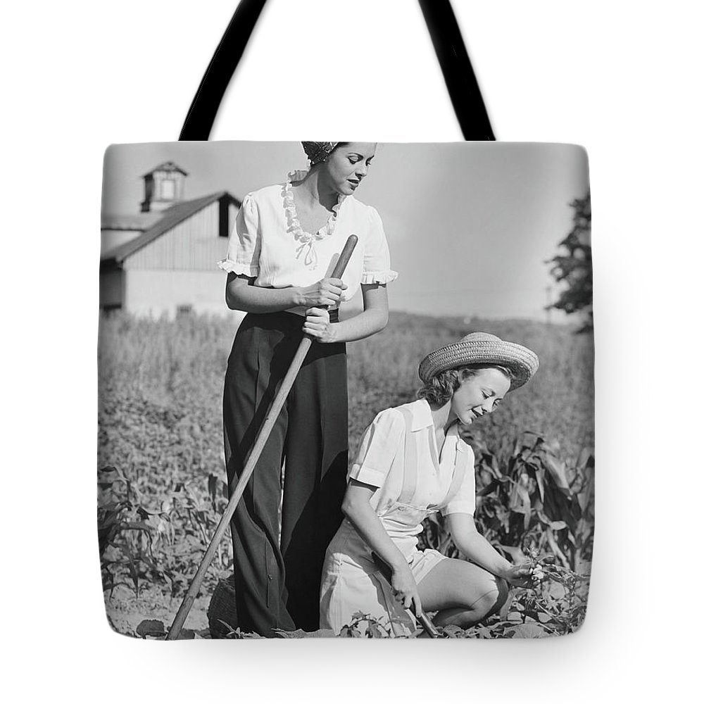 Straw Hat Tote Bag featuring the photograph Two Women Working On Field, B&w by George Marks