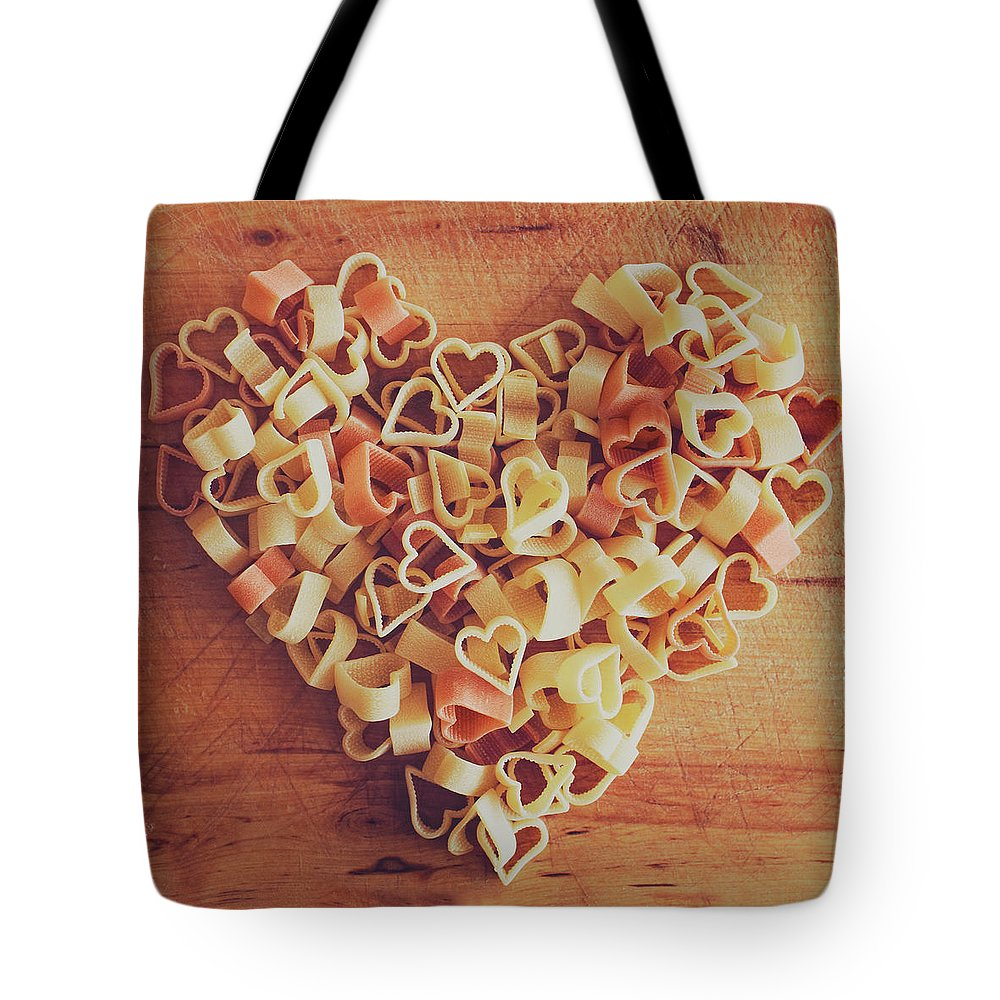 Italian Food Tote Bag featuring the photograph Uncooked Heart-shaped Pasta by Julia Davila-lampe