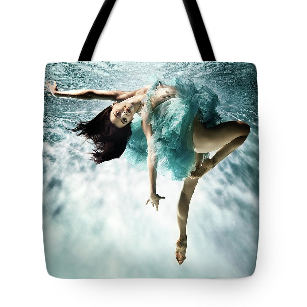 Ballet Dancer Tote Bag featuring the photograph Underwater Ballet by Henrik Sorensen