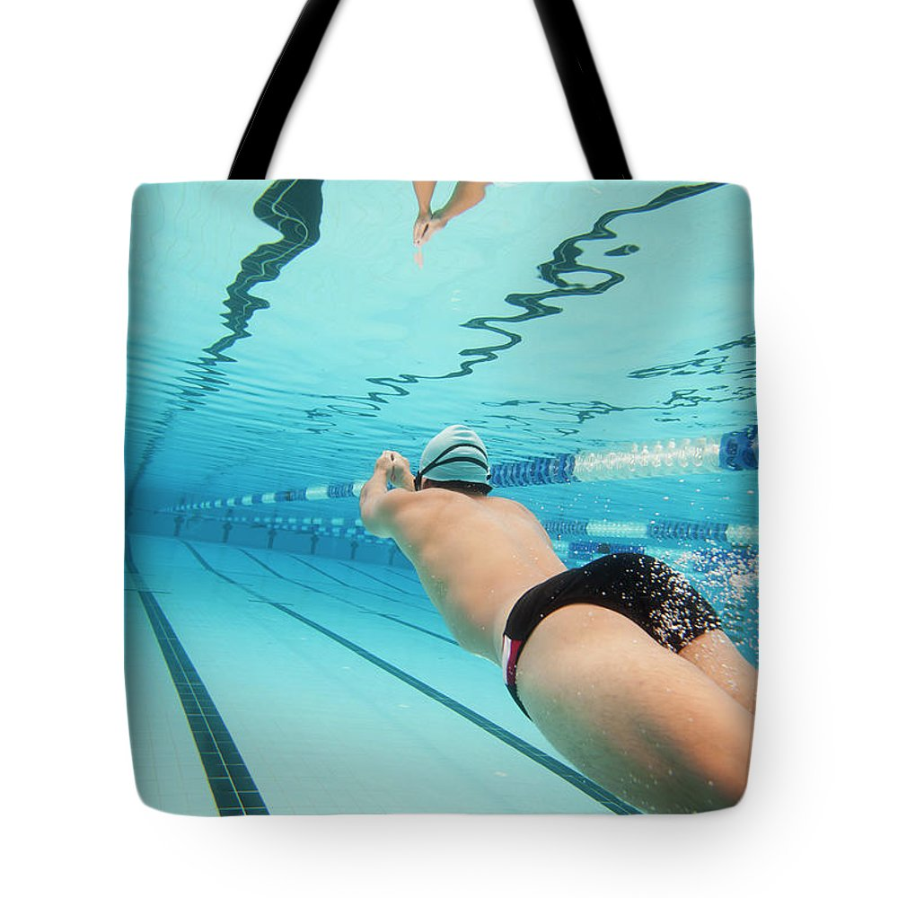 Underwater Tote Bag featuring the photograph Underwater Swimmer by David Freund