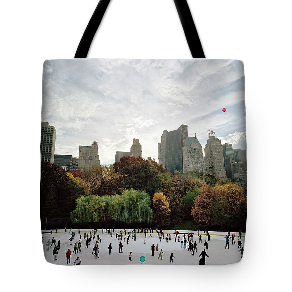 Child Tote Bag featuring the photograph Usa, New York City, People Ice Skating by Carl Lyttle