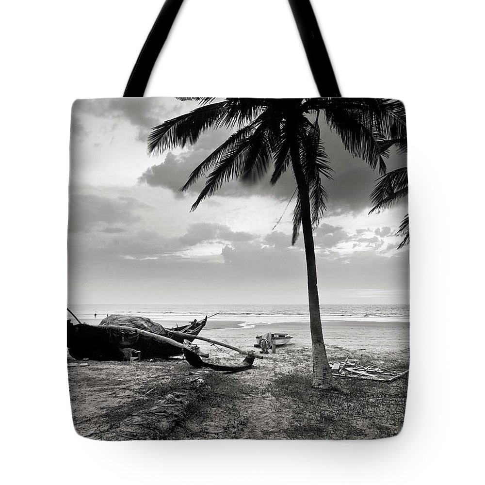 Tranquility Tote Bag featuring the photograph Uttorda Beach , Goa, India Fishing Boat by Anoop Negi