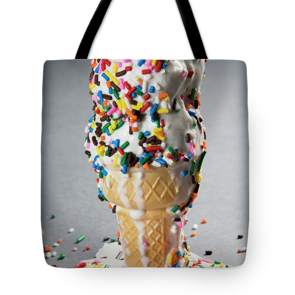 Melting Tote Bag featuring the photograph Vanilla Ice Cream Cones With Sprinkles by Henry Horenstein