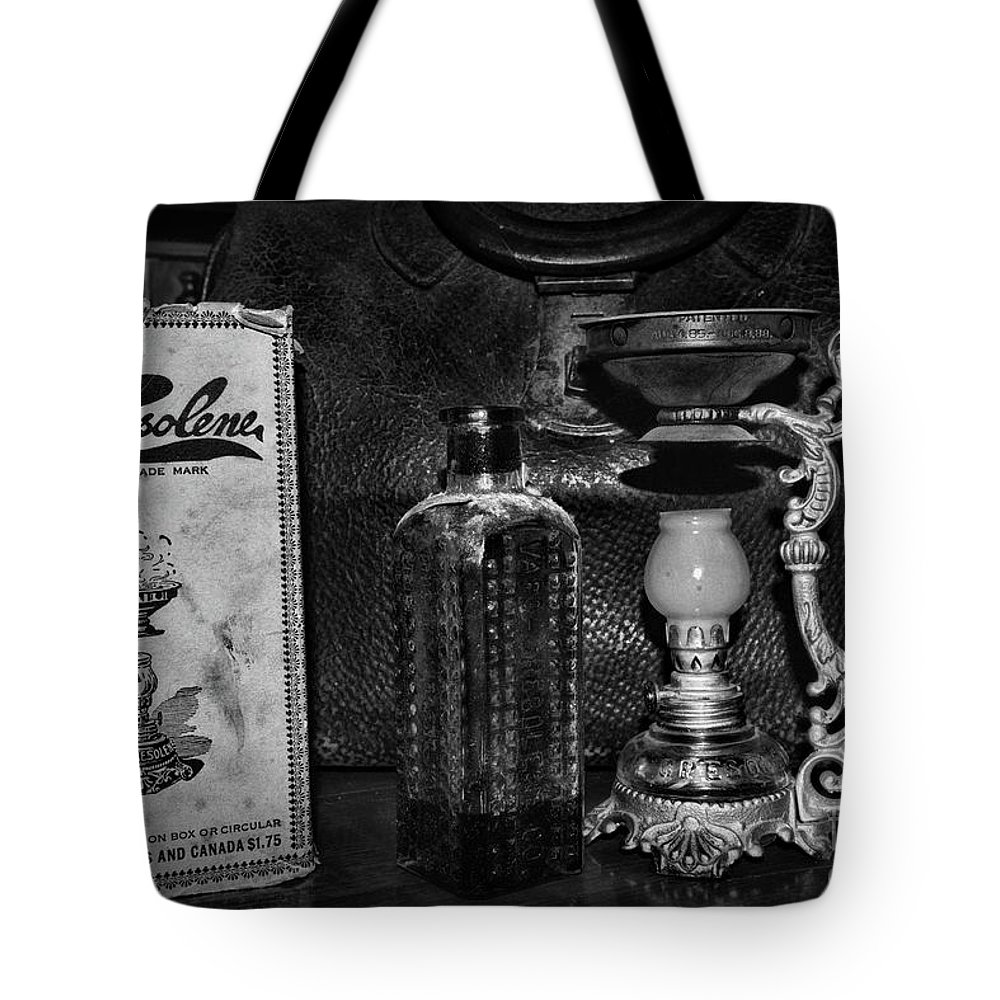 Paul Ward Tote Bag featuring the photograph Vapo-cresolene Vaporizer And Bottle Respiratory Remedy Black And White by Paul Ward
