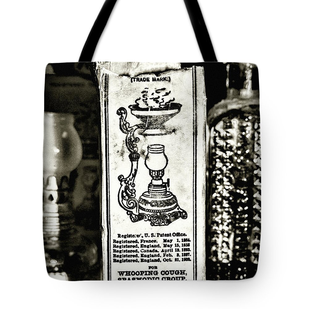 Paul Ward Tote Bag featuring the photograph Vapo-cresolene Vaporizer Liquid Poison Original Packaging Black And White by Paul Ward