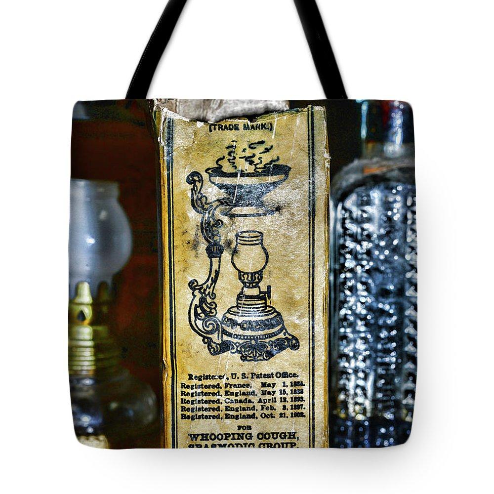 Paul Ward Tote Bag featuring the photograph Vapo-cresolene Vaporizer Liquid Poison Original Packaging by Paul Ward