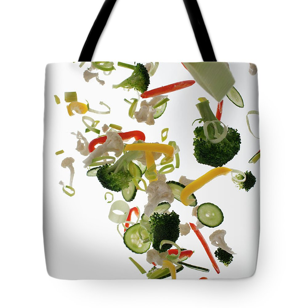 Broccoli Tote Bag featuring the photograph Vegetables Against A White Background by Dual Dual