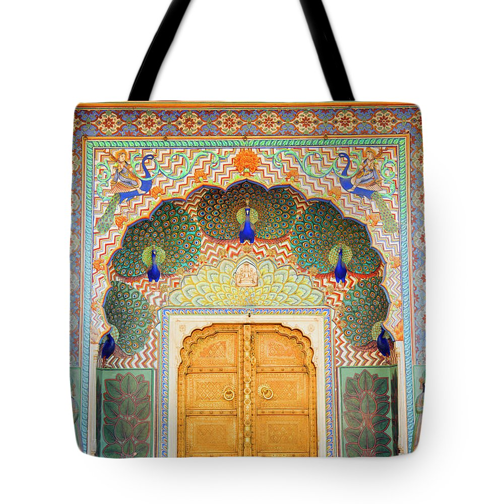 Arch Tote Bag featuring the photograph View Of Peacock Door In Palace by Grant Faint