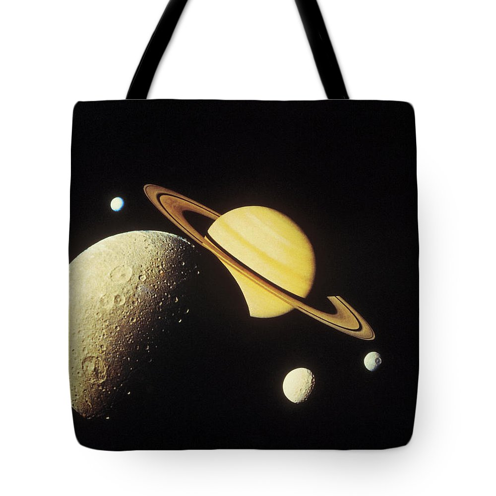 Galaxy Tote Bag featuring the photograph View Of Planets In The Solar System by Stockbyte
