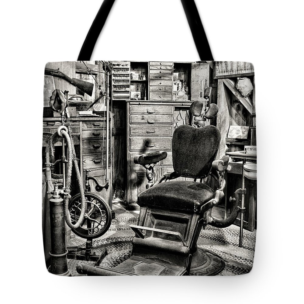 Dentist Tote Bag featuring the photograph Vintage Dentist Office And Drill Black And White by Paul Ward