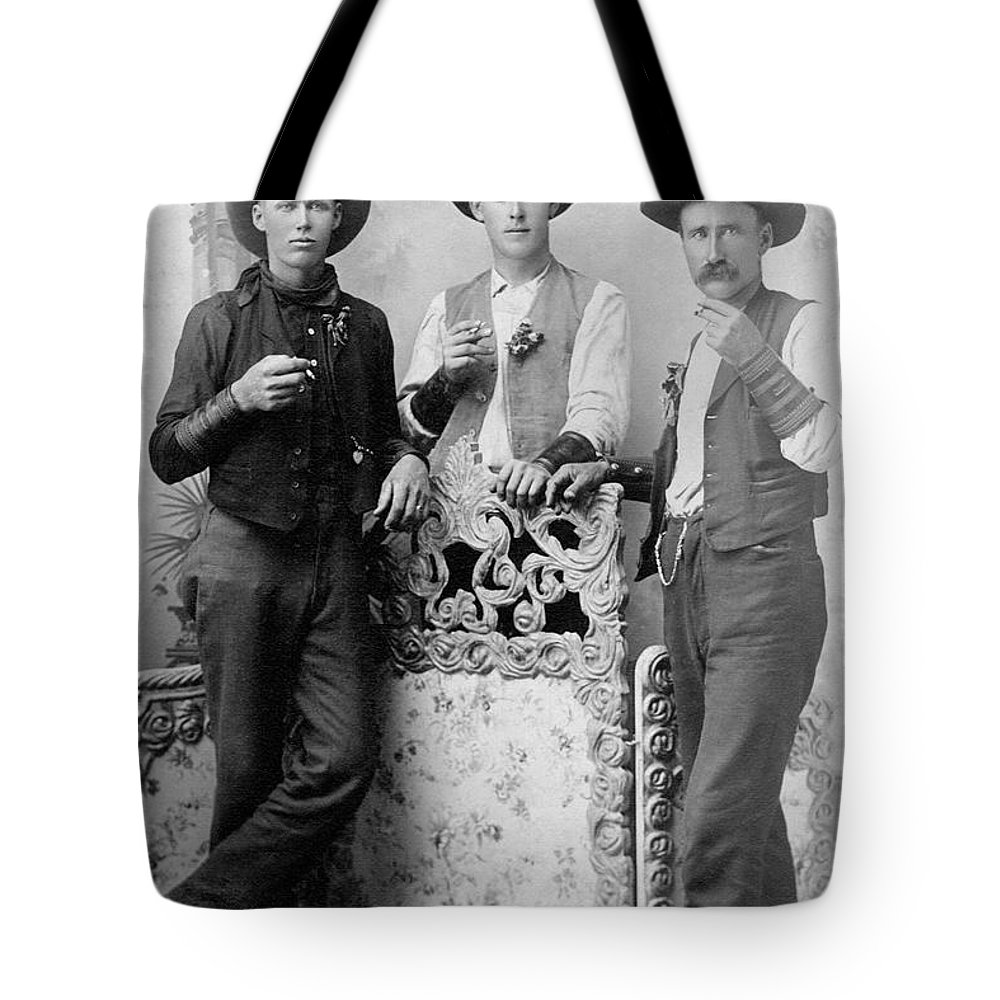 People Tote Bag featuring the photograph Vintage Image Of Cowboys Drinking And by Thinkstock Images