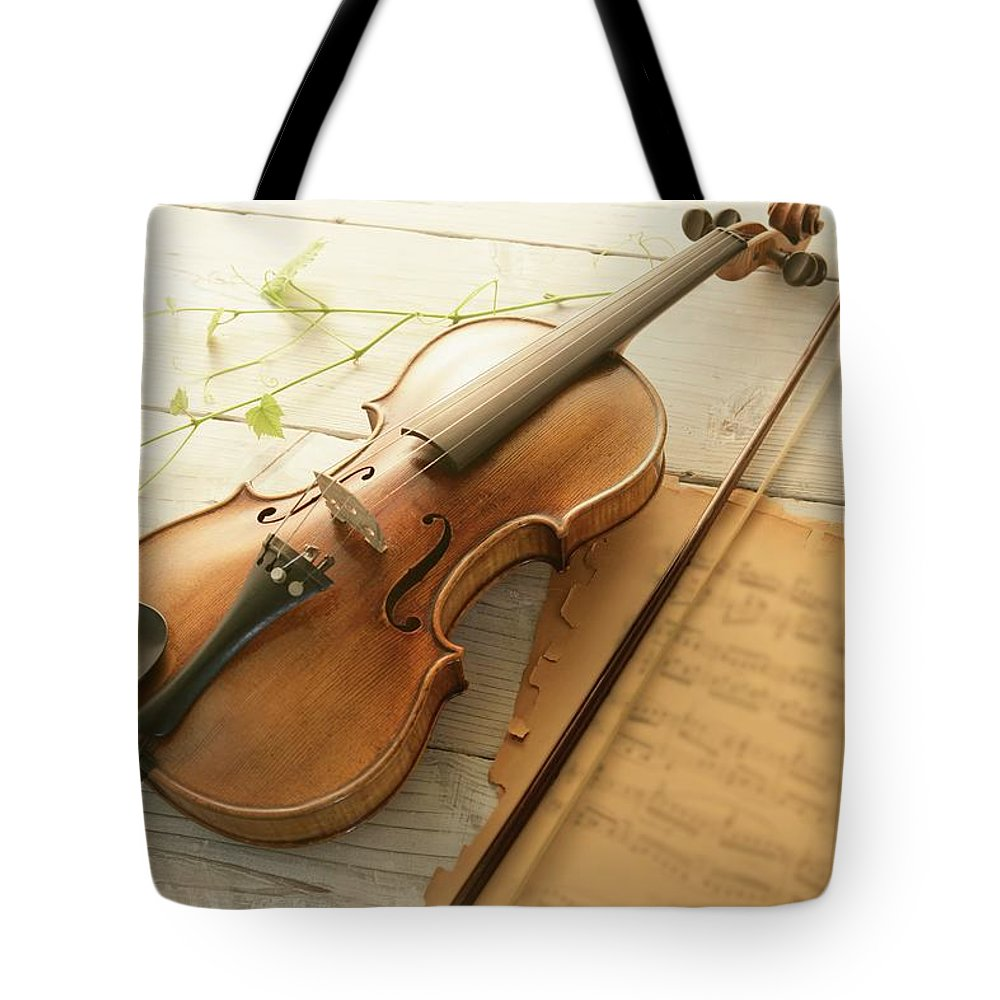 Sheet Music Tote Bag featuring the photograph Violin And Music Sheet by Image Work/amanaimagesrf