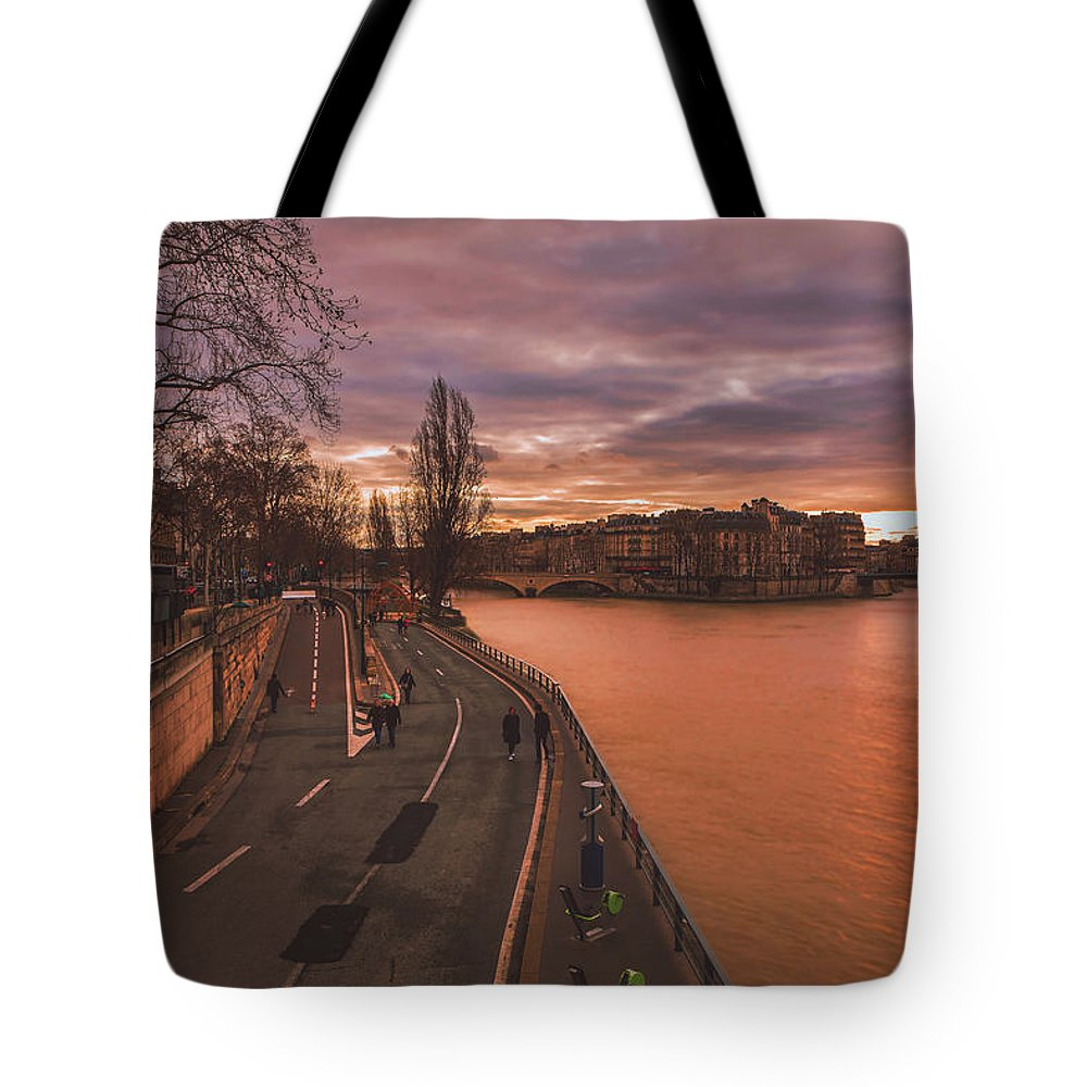 Seine Tote Bag featuring the photograph Walking Along The Seine At Sunset by Pixabay