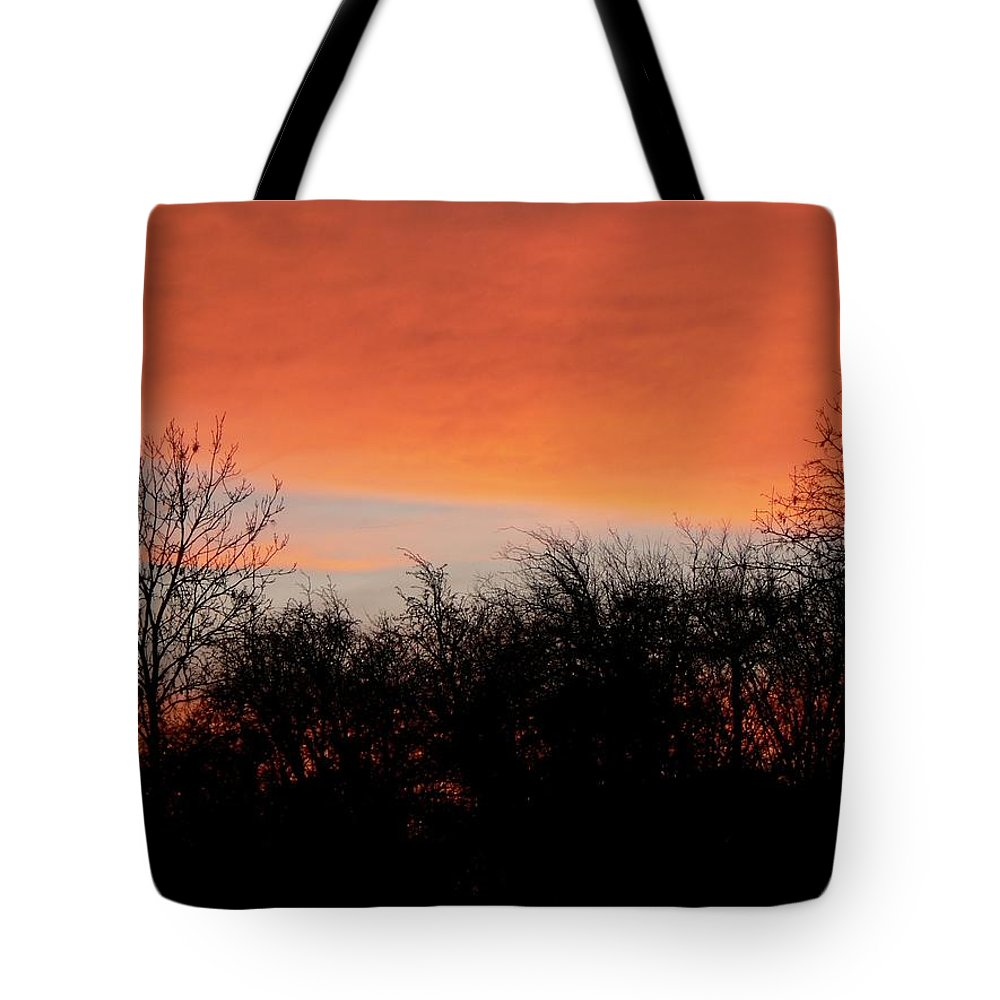 Red Tote Bag featuring the photograph Walking Under A Red Cloud by Lynne Iddon