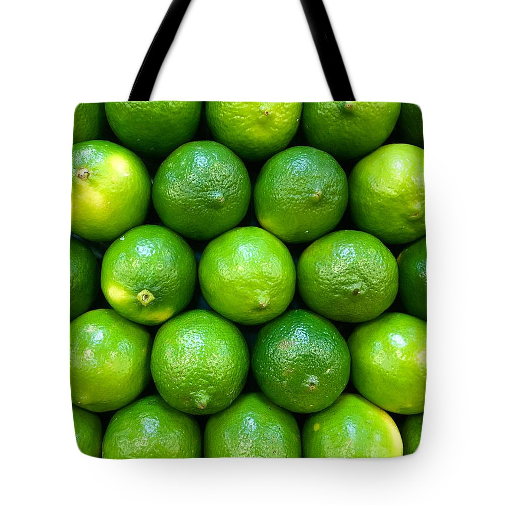 Lime Tote Bag featuring the photograph Wall Of Limes by Nathan Little