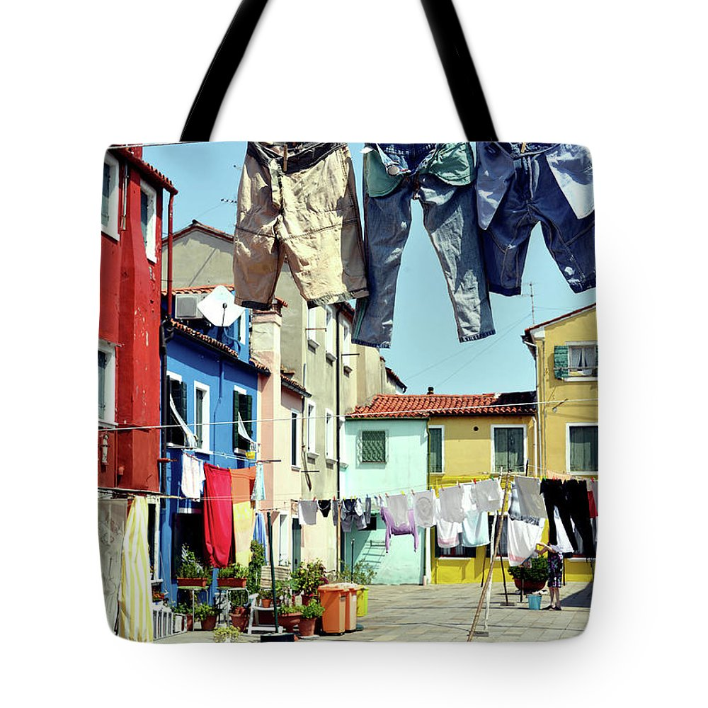 Hanging Tote Bag featuring the photograph Washday In Burano by Paul Biris